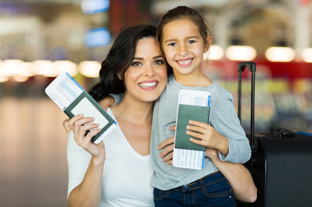 mom and child with passports
